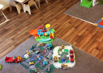 toddler and baby play